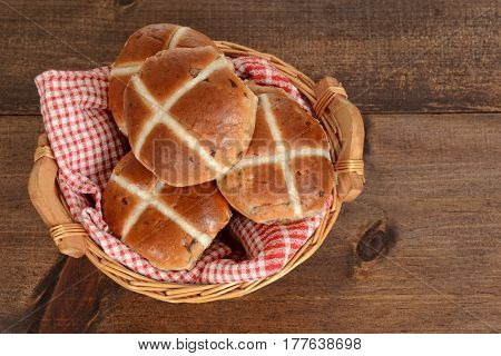 top view hot cross buns in basket on wood table