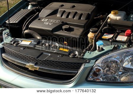 DNIPRO UKRAINE - AUGUST 21 2014: CHEVROLET LACETTI BLUE COLOR UNDER THE HOOD