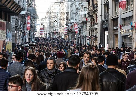 Crowd of diverse People walking along Istiklal street most popular shopping and entertainment place during weekends. Istiklal Caddesi, Istanbul, Turkey, November 19, 2016