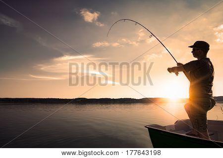 fishing rod lake fisherman men sport summer lure sunset water outdoor sunrise fish