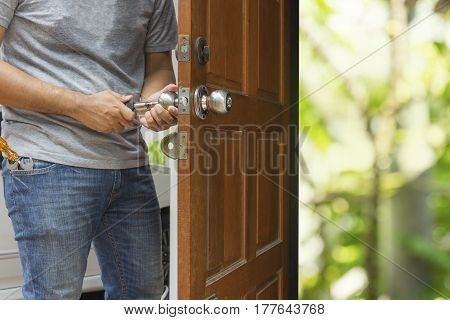 locksmith open the wood door by cylinder tools to green bokeh light - can use to display or montage on product
