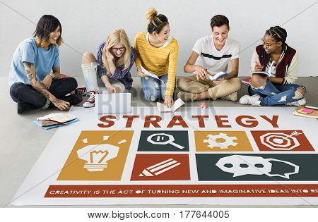 Diverse sitting on the floor discussing creative icons banner