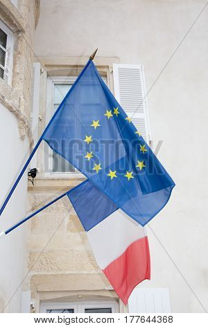 Flags Of European Union And France In Clear Windy Day