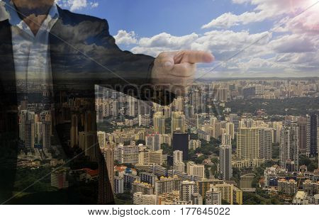 double exposure of old man in black suit point finger and cityscape with len fare filter - can use to display or montage on product