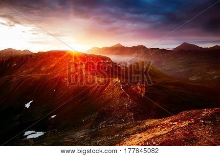A look at the sunlit hills at twilight. Dramatic evening scene. Location place Grossglockner High Alpine Road, Austria. Europe. Climate change. Popular tourist attraction. Explore the world's beauty.