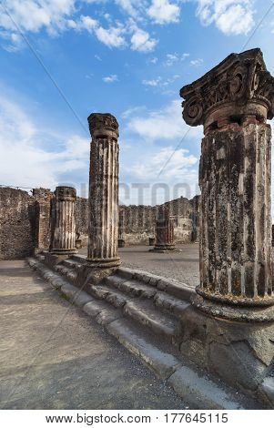 Ionic Colums in the ancient city Pompeii destroyed by the eruption of Vesuvius in the year 79 BC. during the rule of Roman Emperor Vespasian