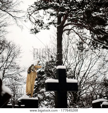 Statue of Jesus Christ at Rasu cemetery in Vilnius Lithuania