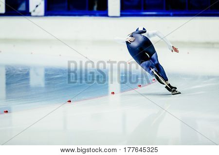 woman athlete speed skater on turn ice arena