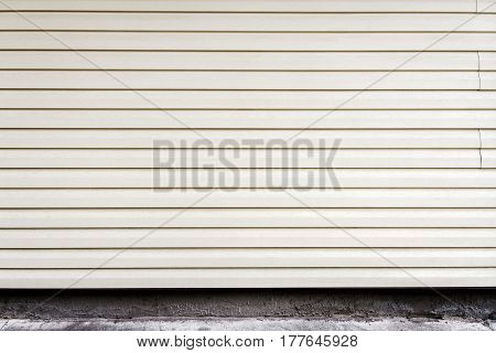 White weathered plastic plank wall on old concrete basement. Architecture detail background
