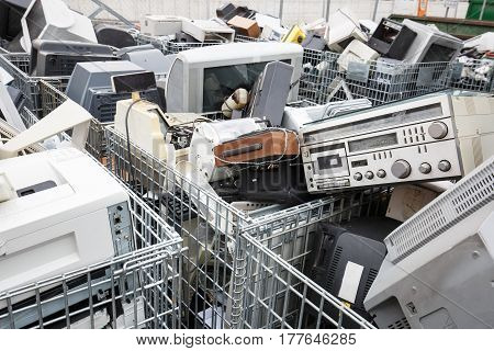 Electronic devices dump site. E-waste disposal management reuse recycle and recovery concept. Electronic consumerism globalization raw material source concept.