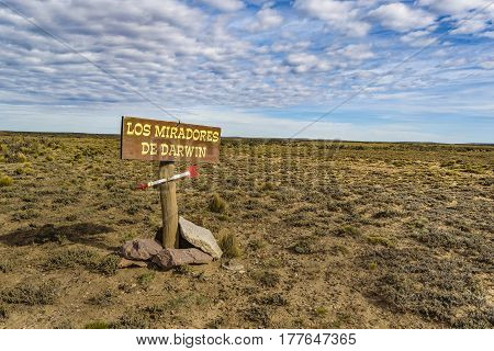 SANTA CRUZ, ARGENTINA, MARCH - 2016 - Signpost with spanish letters which translate as darwing viewpoint located in the middle of arid patagonian landscape scene in Santa Cruz province Argentina