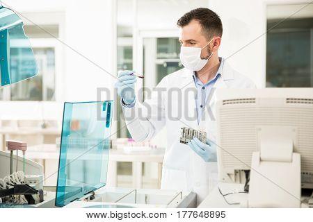 Chemist Analyzing Blood In A Lab
