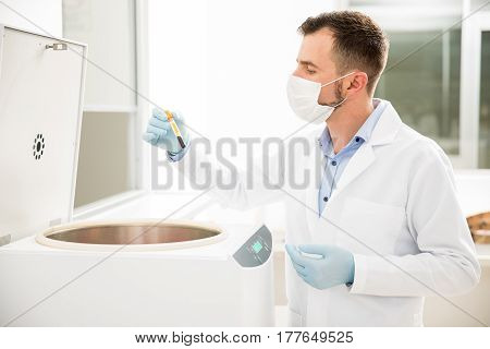 Chemist Using Centrifuge In A Laboratory