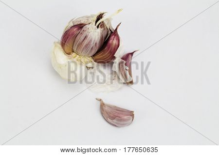 Crushed whole garlic ready for food preparation