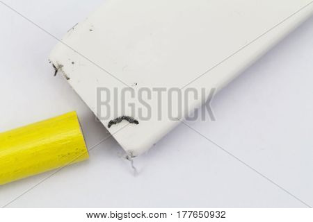 A close up view of a rubber eraser with a yellow pencil