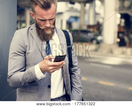 Businessmen Use Mobile Phone Outdoors