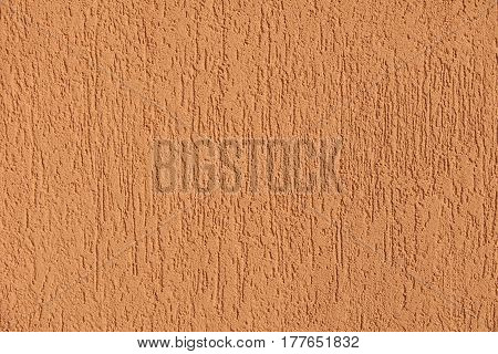 Beige painted cement exterior wall as a textured background