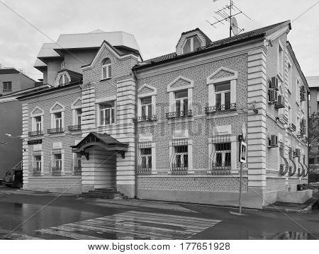 Renovated old style living house on Bolshoy Poluyaroslavskiy pereulok in Moscow. Black and white version.