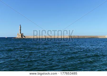 view of light house near sea under blue sky