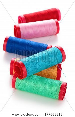 Collection of colorful spools. Isolated on white background.