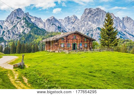 Panoramic View Of Scenic Mountain Landscape In The Alps With Traditional Old Mountain Chalet And Fre