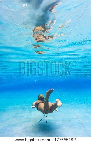 Woman at swimming pool underwater