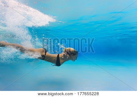 Woman at swimming pool underwater