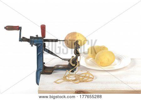original old maschine apple peeler and potato made of metal