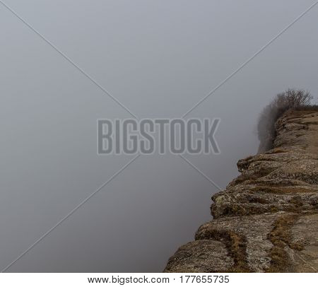 The mist hides the most dangerous part of a mountain: the precipice