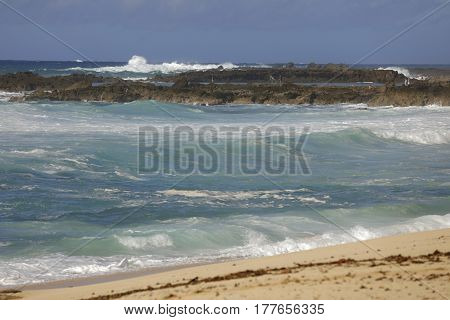Telephoto shot of ocean surf in Oahu North Shore Hawaii