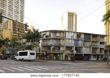 HONOLULU USA - FEBRUARY 15 2017: Image of mixed use reidential and commercial building in Waikiki Beach OahuHawaii