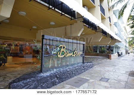 WAIKIKI USA - FEBRUARY 17 2017: Stock photo of the entrance to the Aqua Bamboo Resort in Waikiki Beach Oahu Hawaii USA