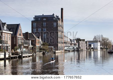 Houses and apartments along the oude rijn river near Bodegraven in the Netherlands
