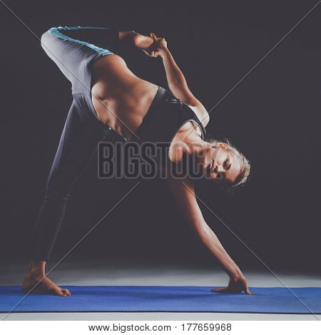 Portrait of sport girl doing yoga stretching exercise
