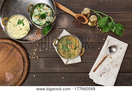 Vegetarian dish, creamy mushroom indian soup bowl. Traditional indian cuisine meal on wooden served table background. Healthy eastern local cuisine restaurant food
