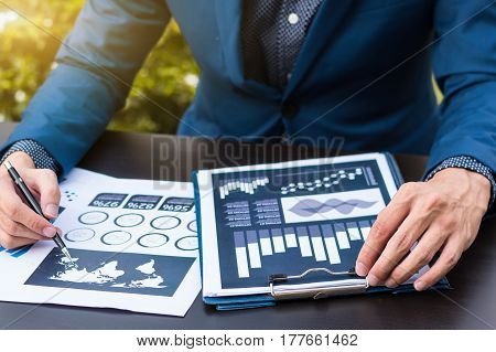 Business Statistics Success Concept : Businessman Analytics Financial Chart And Graph