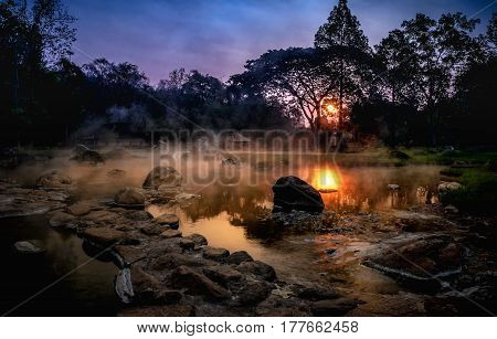Volcanic Natural Hot Spring Mineral Water Pool With Steam Spa And Sun Reflect Light