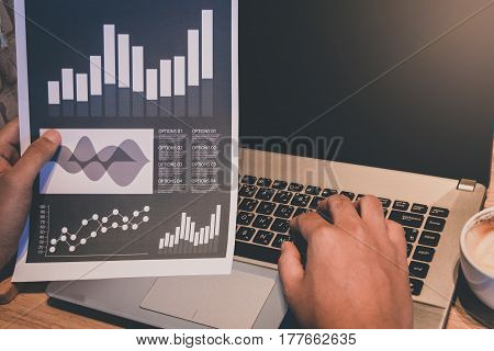 Business Trading Concept : Man Trade Stock And Forex In Notebook And Analysis Market