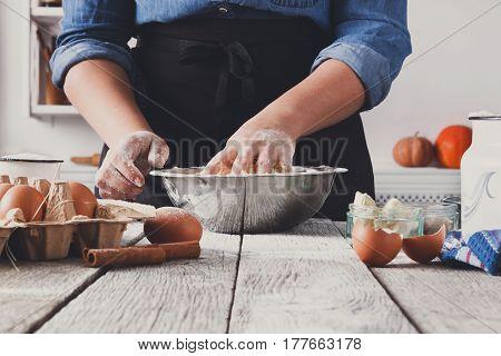 Baking concept. Unrecognizable woman knead yeast sweet dough. Female baker closeup
