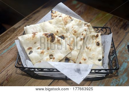 naan Indian style bread in basket fresh baked