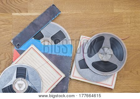Vintage magnetic audio tapes, reel to reel type, paper box on the grunge wooden floor