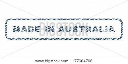 Made In Australia text textile seal stamp watermark. Blue jeans fabric vectorized texture. Vector caption inside rounded rectangular banner. Rubber sign with fiber textile structure.