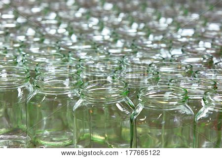 Conveyor line of bottles.Glass dishes and containers in an industrial factory.