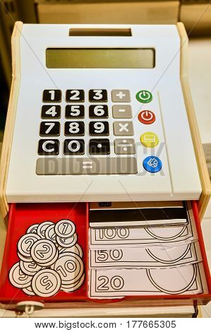 children's cash register toy with colored buttons