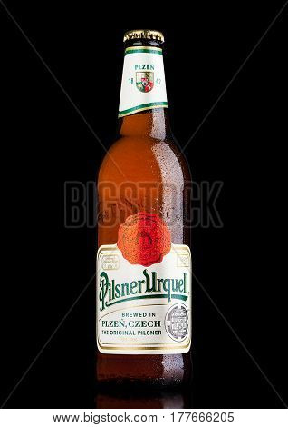 London,uk - March 21, 2017 :  Bottle Of Pilsner Urquell Beer On Black.it Has Been Produced Since 184