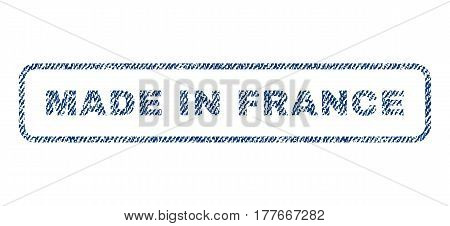Made In France text textile seal stamp watermark. Blue jeans fabric vectorized texture. Vector caption inside rounded rectangular banner. Rubber sign with fiber textile structure.