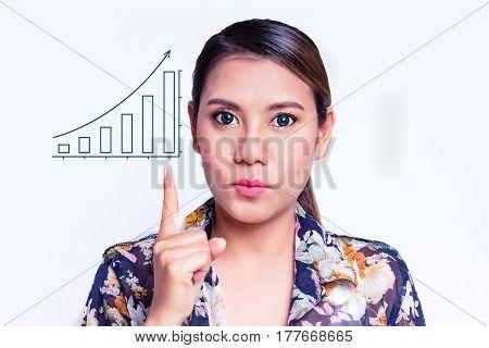 Young pretty woman pointing at increasing bar graph