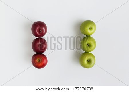Top view of red and green apples in a row isolated on the white background