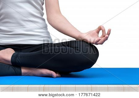 Young woman keeps calm and meditates while practicing yoga to explore the Inner Peace. Yoga and meditation have good benefits for health.