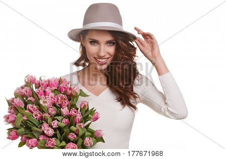 Beauty delicate woman smelling spring flowers